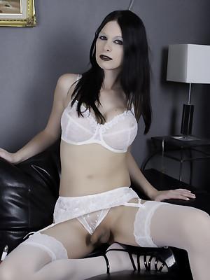 Kinky brunette tranny Hannah Sweden in garter stockings & white lingerie