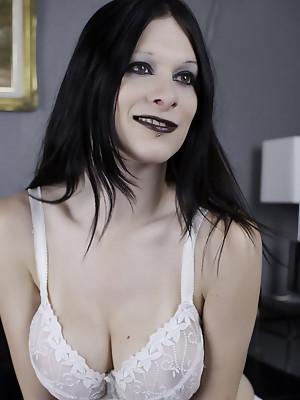 Kinky brunette tgirl Hannah Sweden in garter stockings and white lingerie